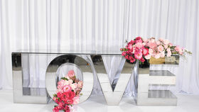 Image of a LOVE SILVER STAINLESS STEEL DISPLAY LETTER TABLE