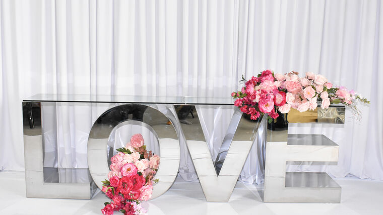 Picture of a LOVE SILVER STAINLESS STEEL DISPLAY LETTER TABLE