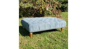 Image of a Teal Tufted Ottoman