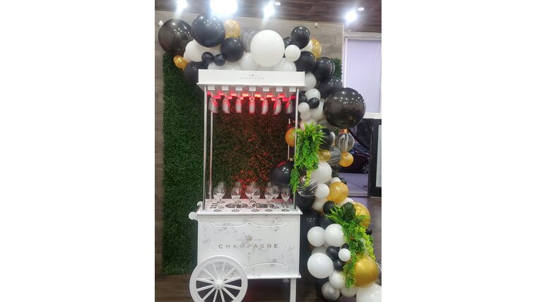 Picture of a Beverage Cart with Organic Balloon Garland & Greenery