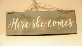 """Image of a """"Here She Comes"""" Blue, Painted, Wooden Sign"""