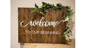 """Image of a """"Welcome to Our Beginning"""" Sign"""