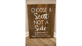 """Image of a """"Choose a Seat"""" Sign"""