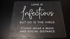 """Image of a """"Love is Infectious"""" Acrylic Sign"""