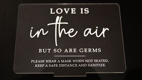 """Image of a """"Love Is In The Air"""" Acrylic Sign"""