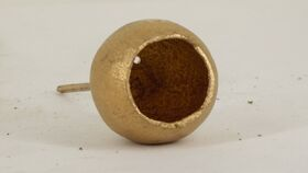 Image of a Gold Pod Cup on a Pick