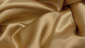 "Image of a Antique Gold Polyester 90"" 156"" Cvlinens Tablecloths"