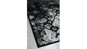 Image of a Black pattern area rug
