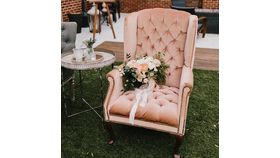 Image of a Blush Wingback Chair