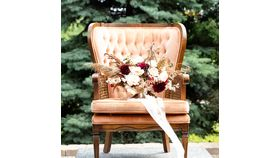 Image of a Peach Velvet Wicker Chair