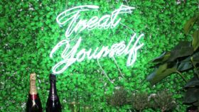 "Image of a ""Treat Yourself"" Neon Sign"