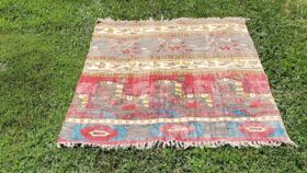 Image of a Red + Blue Tribal Print Rug