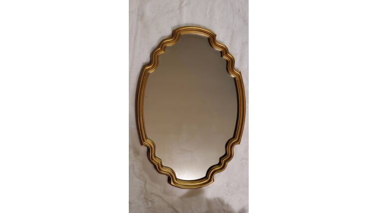 Picture of a Gold Framed Oval Mirror
