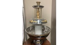 Image of a Gold and Silver Drink Fountain