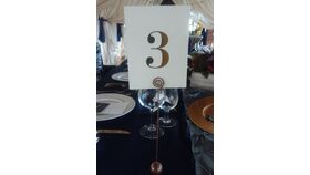 Image of a Copper Ball Stand Table Number Holders