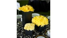 Image of a Multi Vessel Yellow Floral Centerpiece