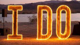 "Image of a ""I DO"" Light up wood sign"