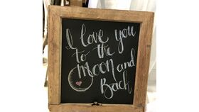 """Image of a """"I Love you to the Moon and Back"""" wood chalkboard sign"""