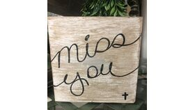 """Image of a """"Miss You"""" Wood sign"""