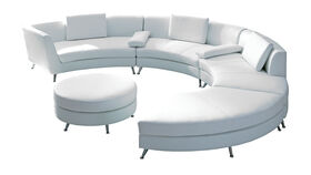 Image of a White Leather Curved Sectional with Ottoman
