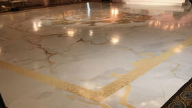Image of a 16 FT x 32FT Marble Floor Wrap (Full Print) w/ Gold Foil Monogram Design in Center