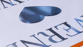 Image of a 16FT x 32FT Gloss White Vinyl Floor Wrap w/ Silver Foil Monogram Design in Center